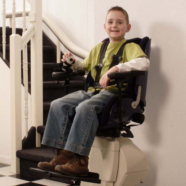 The Handicare Freecurve curved stair lift fits this child perfectly!