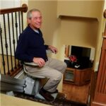 Man riding in stair lift in north Georgia home